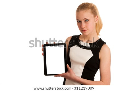 Beautiful young caucasian business woman with blond hair working on tablet