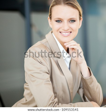 beautiful young caucasian businesswoman closeup portrait - stock photo