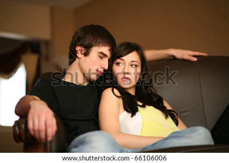 beautiful young caucasian couple having relationship problems - stock photo