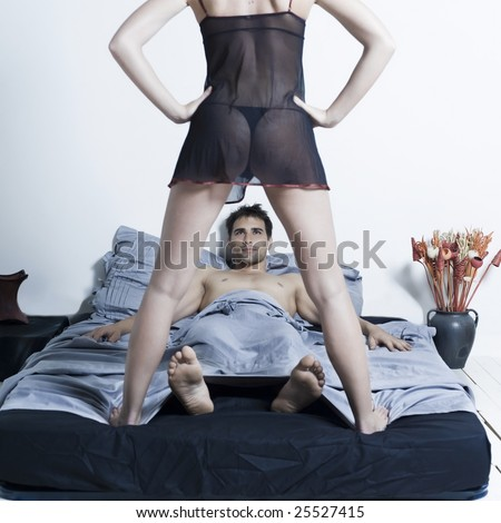 beautiful young caucasian couple in a bed on isolated background - stock photo