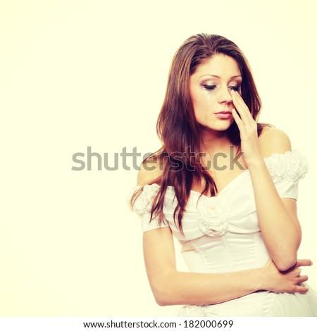 Beautiful young caucasian sad bride crying - stock photo