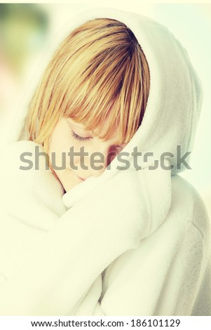 Beautiful young caucasian woman in bathrobe after bath calm portrait. - stock photo