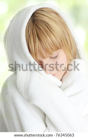 Beautiful young caucasian woman in bathrobe after bath calm portrait,  on abstract green background - stock photo