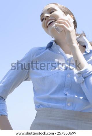 beautiful young Caucasian woman outdoor - stock photo
