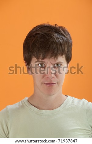 Beautiful young Caucasian woman senses something isn't right - stock photo