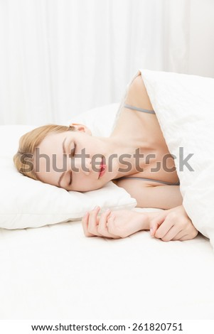 Beautiful young caucasian woman sleeping on the bed