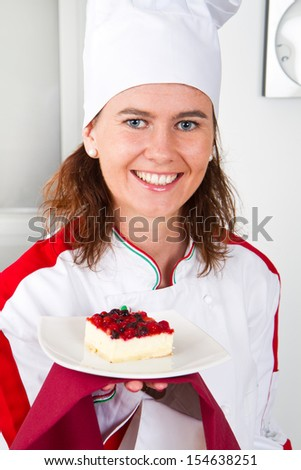 beautiful young chef with dessert  - stock photo