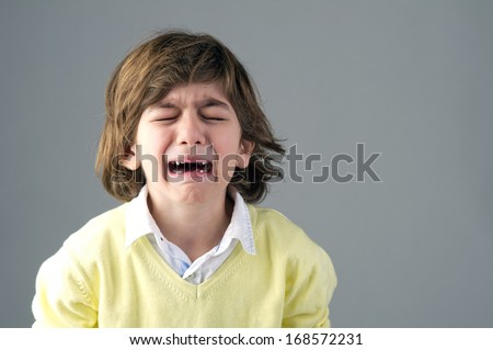 Beautiful young child crying  - stock photo