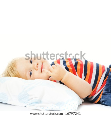 Beautiful young child waking up in the morning. Isolated on white background - stock photo