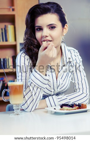Beautiful young college student on a cafe. - stock photo