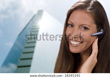 Beautiful young corporate receptionist or customer service rep or admin.  Shallow dof. - stock photo