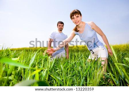 Beautiful young couple are enjoying summer - stock photo