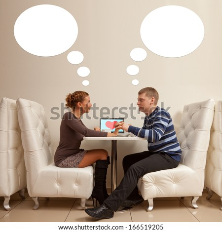 stock photo beautiful young couple are together at a table with a laptop in cafe it s their first date 166519205 - Romance Advice