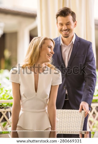 Beautiful young couple at restaurant. Romantic date.