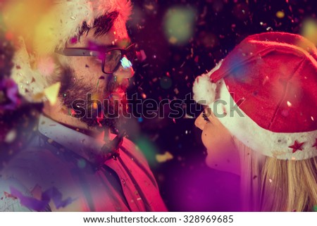 Beautiful young couple dancing at midnight at New Year's Party - stock photo