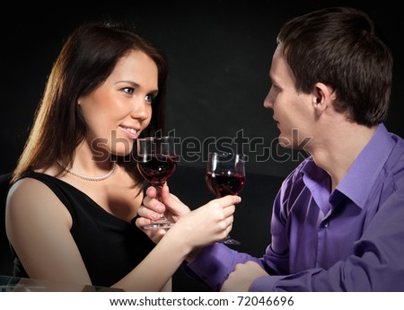 beautiful young couple drinking wine - stock photo