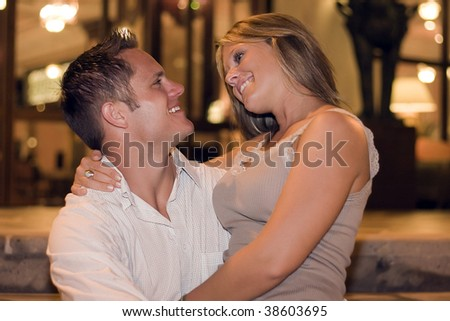 Beautiful young couple embracing.