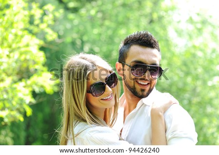 Beautiful young couple embracing in nature - stock photo