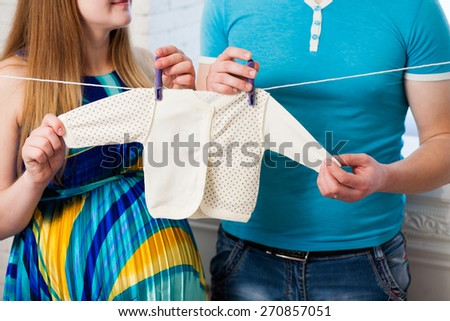 Beautiful young couple expecting baby. Pregnant couple.  - stock photo