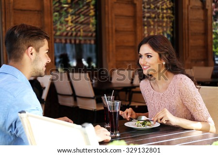 beautiful young couple have dating in cafe - stock photo