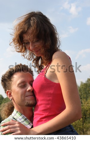 Beautiful young couple having fun on the park - stock photo