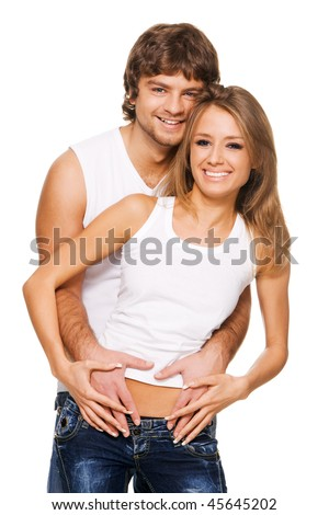 Beautiful young couple in casual clothing - stock photo