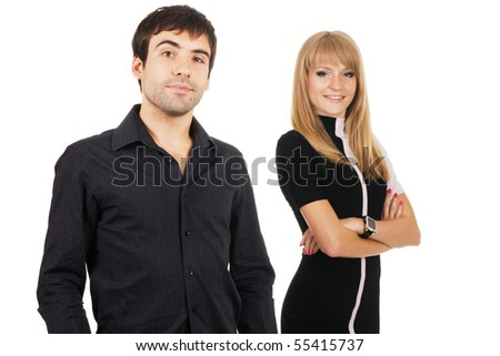 Beautiful young couple in casual clothing, focus on man - stock photo