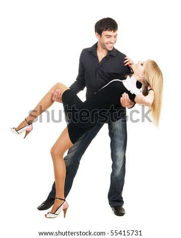 Beautiful young couple in casual clothing, white background - stock photo