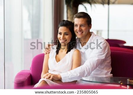 beautiful young couple in coffee shop - stock photo