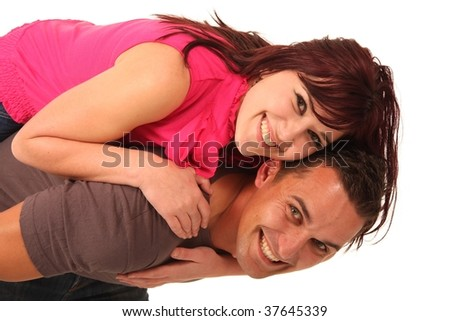 Beautiful young couple in love and playing a game