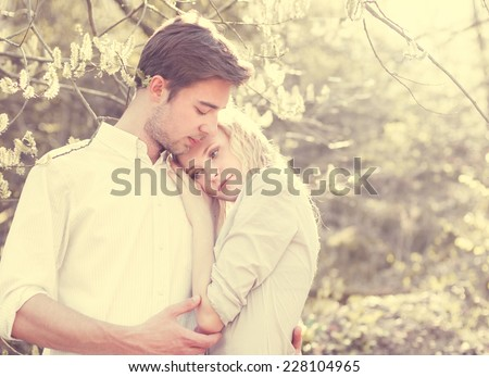 beautiful young couple in love in the spring - stock photo