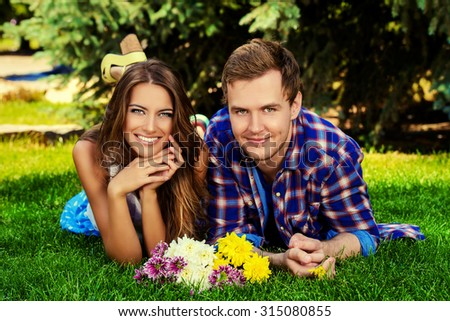 Beautiful young couple in love. Romantic summer day.  - stock photo