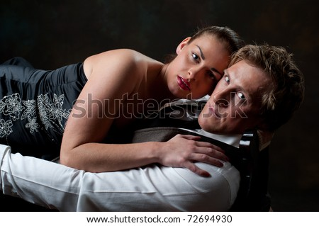 Beautiful young couple in loving embrace