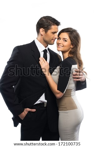 Beautiful young couple in suit and dress isolated on white background  - stock photo