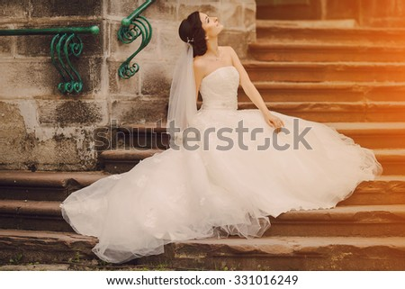 beautiful young couple in wedding sunny summer day