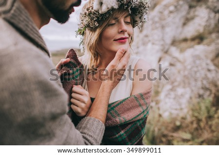 beautiful young couple on a background of rock cliff - stock photo