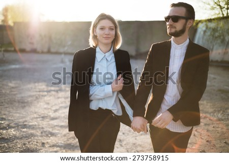 beautiful young couple on a sunset - stock photo