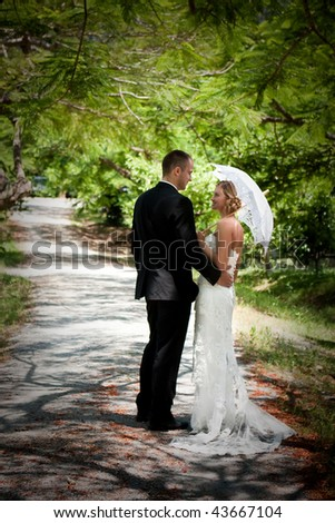 beautiful young couple on their wedding day - stock photo