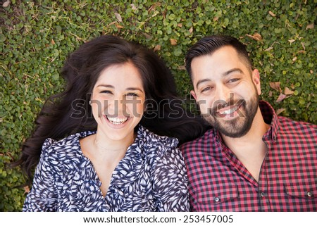 Beautiful young couple relaxing and having fun at a park