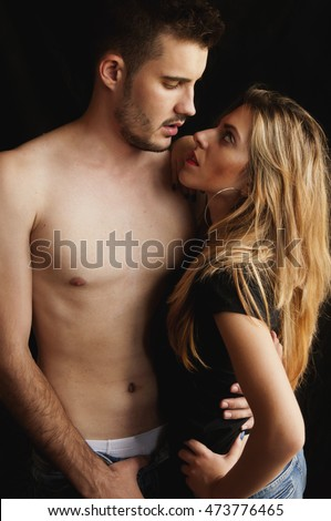 Beautiful young couple sharing moments of passion and intimacy