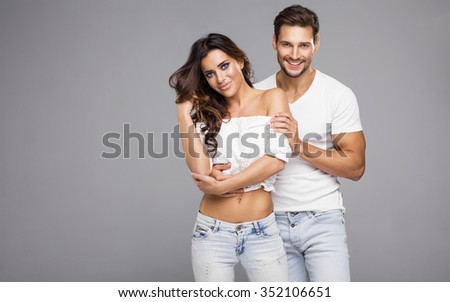 Beautiful young couple smiling - stock photo