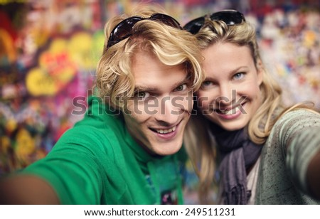 Beautiful young couple taking selfie of themselves - stock photo