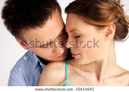 Beautiful young couple tender love portrait - stock photo
