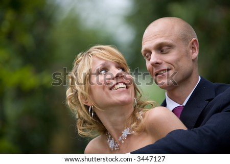 Beautiful young couple; the woman looking up to her new husband