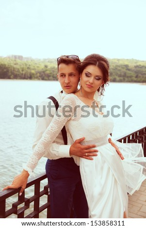 beautiful young couple,unusual wedding photos with humor - stock photo