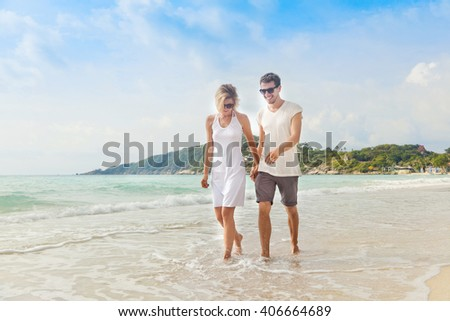 Two men walking on beach stock photo 35189620 shutterstock for Tropical vacations for couples