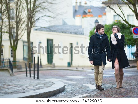Beautiful young couple walking in Paris