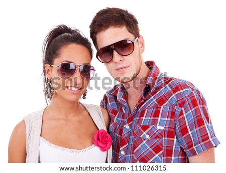 Beautiful young couple wearing sunglasses isolated on white