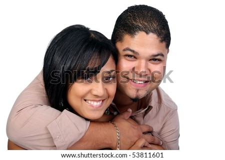 Beautiful young couple with attractive smiles against white background