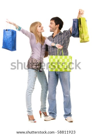 Beautiful young couple with shopping bags, isolated on white background - stock photo